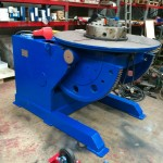 8. Used 3 Tonne Welding Positioner, blue with 3 jaw chuck